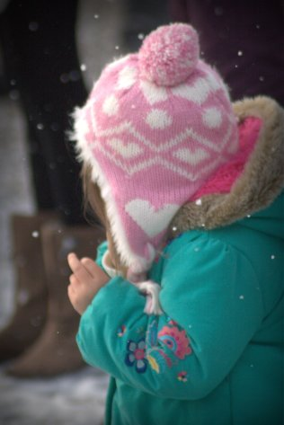 little girl touching snow 2