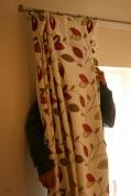behind a curtain