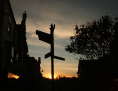 signpost and sunset